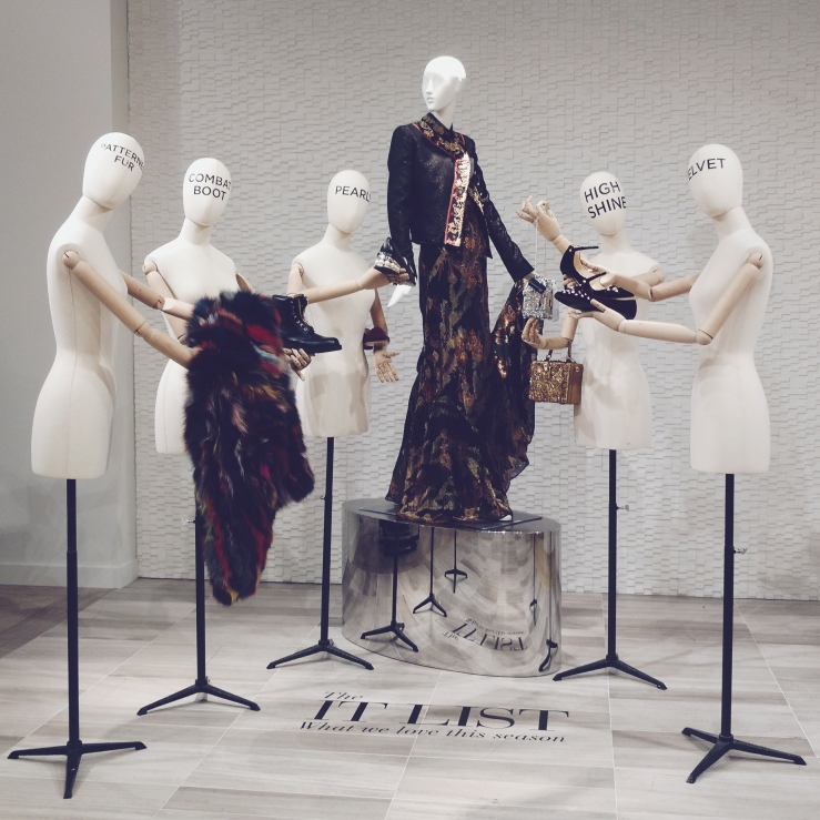the silver birdcage purse held by 'HIGH SHINE' mannequin was to DIE for