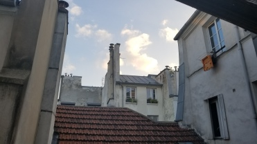 7:45pm and the sun starts rising with aggression in Paris... weird city; sun sets so late!